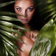 Big green leaf covering the woman's body with fresh clear skin — Stock Photo