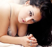 Lingerie glamour beautiful girl in bed — Stock Photo