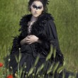 Fine art photos of glamor woman dressed as a crow — Stock Photo
