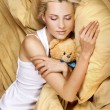 Sleeping Girl Hugging Teddy Bear — Stock Photo #8957987