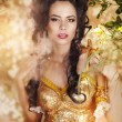 Sensual woman in long yellow dress and flowers — Stock Photo #9033042
