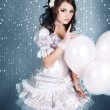 Princess in white with white balloons in the clouds — Stock Photo
