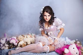 Beautiful princess sitting with toys — Stock Photo