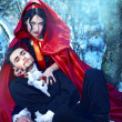Red Riding Hood in the woods with a man-wolf — Stock Photo #9081873