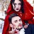 Foto Stock: Red Riding Hood in the woods with a man-wolf