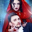 Red Riding Hood in the woods with a man-wolf — Stock Photo #9081880