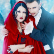 Stock Photo: Red Riding Hood in the woods with a man-wolf