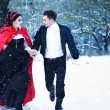 Red Riding Hood in the woods with a man-wolf — Stock Photo