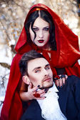 Red riding hood in den wald mit einem mann-wolf — Stockfoto
