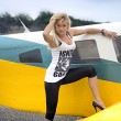 Woman near airplane — Stock Photo