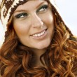 Smiling attractive woman in winter fur hat close-up  — Stock Photo