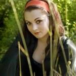 Beautiful girl on a green meadow — Stock Photo