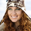 Smiling attractive woman in winter fur hat close-up - Stock Photo