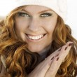 Smiling attractive woman in winter fur hat close-up studio portrait on white — Stock Photo #9596138