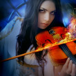 Young attractive woman playing violin - Стоковая фотография
