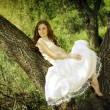 Girl with red hair near the tree — Stock Photo