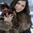 Outdoor portrait of young beautiful woman - holding her little dog in her arms — Stock Photo #9597614