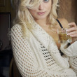 Pretty blond with glass of champagne — Stock Photo