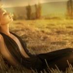 Young beautiful girl near haystacks — Stock Photo