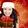 Beautiful girl with gift for Christmas — Stock Photo #9599143