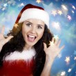 Portrait of beautiful happy girl wearing Santa Claus clothes — Стоковая фотография