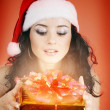 Beautiful girl with gift for Christmas — Stock Photo