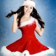 Stock Photo: Portrait of beautiful happy girl wearing Santa Claus clothes