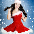 Portrait of beautiful happy girl wearing Santa Claus clothes  — Stockfoto