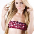 Beautiful blond woman wearing pink lingerie over white — Stock Photo #9599531
