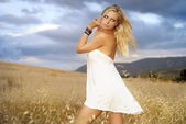 Beautiful young blonde girl posing in sunset light — Stock Photo