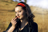 Woman with cherry — Stock Photo