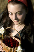 Girl with basket of berries — Stock Photo