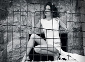 Sexy girl behind the bars — Stock Photo