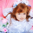Beautiful little girl in dress with long hair — Stock Photo