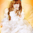 Beautiful little girl in dress with long hair — Stock Photo #9600046