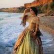 A beautiful young girl in a vintage dress is in the sea — Stock Photo #9722666