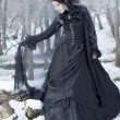 Beautiful gothic girl in the snow - Stock Photo