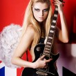 Girl angel with guitar - Stock Photo