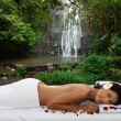 Spa treatment outdoor in waterfall — Stock Photo