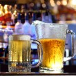 Beer served at a bar - Stock Photo