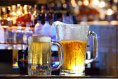 Beer served at a bar — Stock Photo