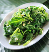 Stir fried water spinach with garlic — Stock Photo