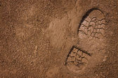 Bootprint on mud — Stock Photo