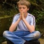 Young boy praying — Stock Photo