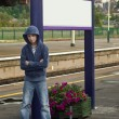 Hooded Thug at train station — Stock Photo