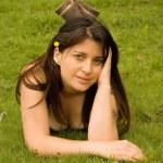 Woman laying on grass — Stock Photo #8670701