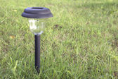 Solar power garden light — Stock Photo