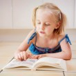 A little four year old girl reading — Stock Photo #8704952