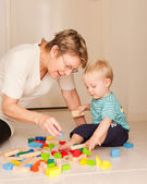 A little boy plays with his grandmother — Stock Photo