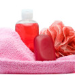 Bathroom accessories covered with towel — Stock Photo